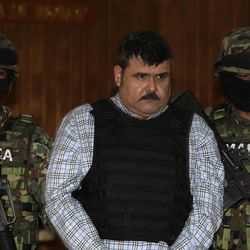 """Mexican Navy marines escort Jorge Eduardo Costilla Sanchez, aka """"El Coss,"""" as he is shown to the press at the Mexican Navy's Center for Advanced Naval Studies in Mexico City,Thursday, Sept. 13, 2012. Costilla is believed to be the alleged leader of the Gulf drug cartel. One of Mexico's most-wanted men, the 41-year-old is charged in the U.S. with drug-trafficking and threatening U.S. law enforcement officials. U.S. authorities offered $5 million for information leading to his arrest."""