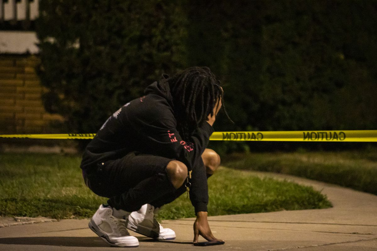 A man reacts at the scene after a 22-year-old man was shot in the face early Monday in a backyard in the 9500 block of South Yale Avenue in Longwood Manor on the South Side.
