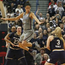 UConn's Kia Nurse (11) is faked out by Notre Dame's Marina Mabrey (3) during the Notre Dame Fighting Irish vs UConn Huskies women's college basketball game in the Women's Jimmy V Classic at the XL Center in Hartford, CT on December 3, 2017.
