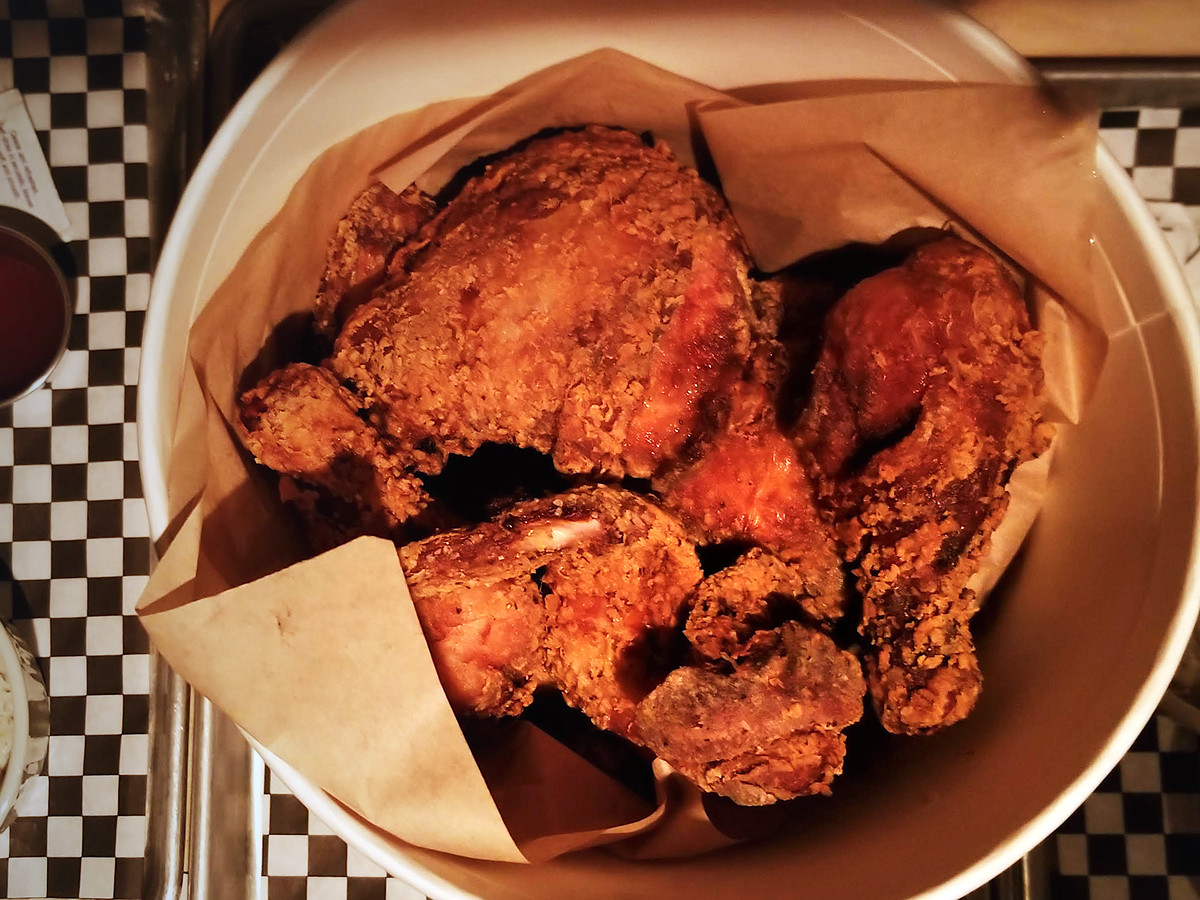 Bucket of fried chicken with sides