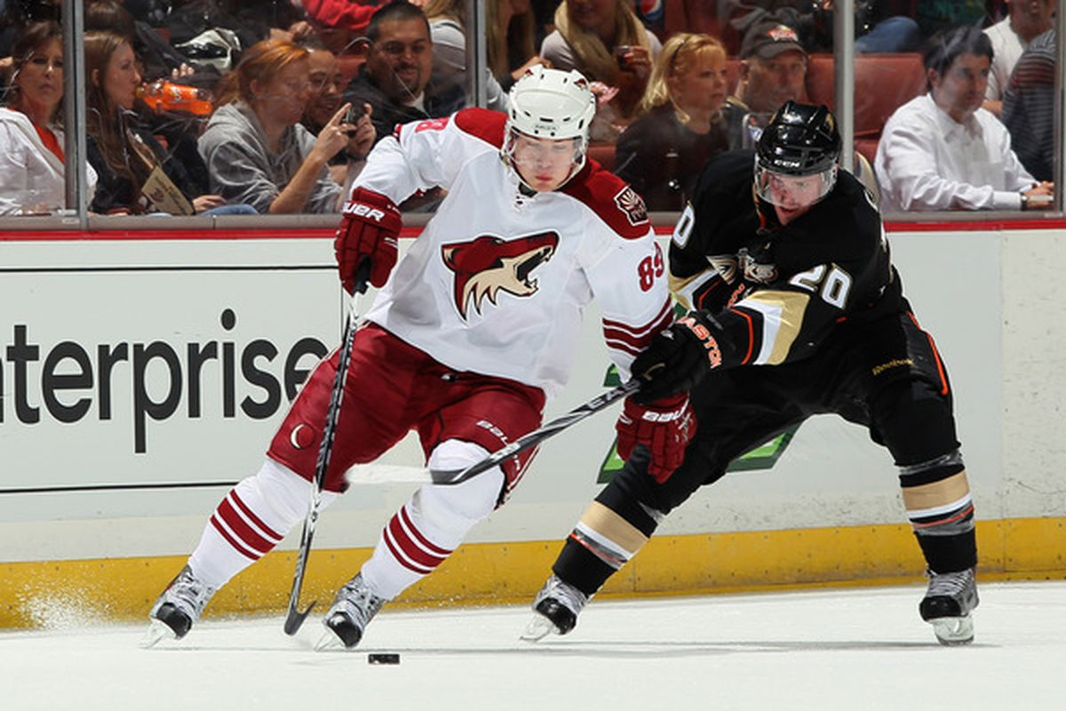 Mikkel Boedker #89 of the Phoenix Coyotes is pursued by Ryan Carter #20 of the Anaheim Ducks in the third period at Honda Center in Anaheim California. (Photo by Jeff Gross/Getty Images)