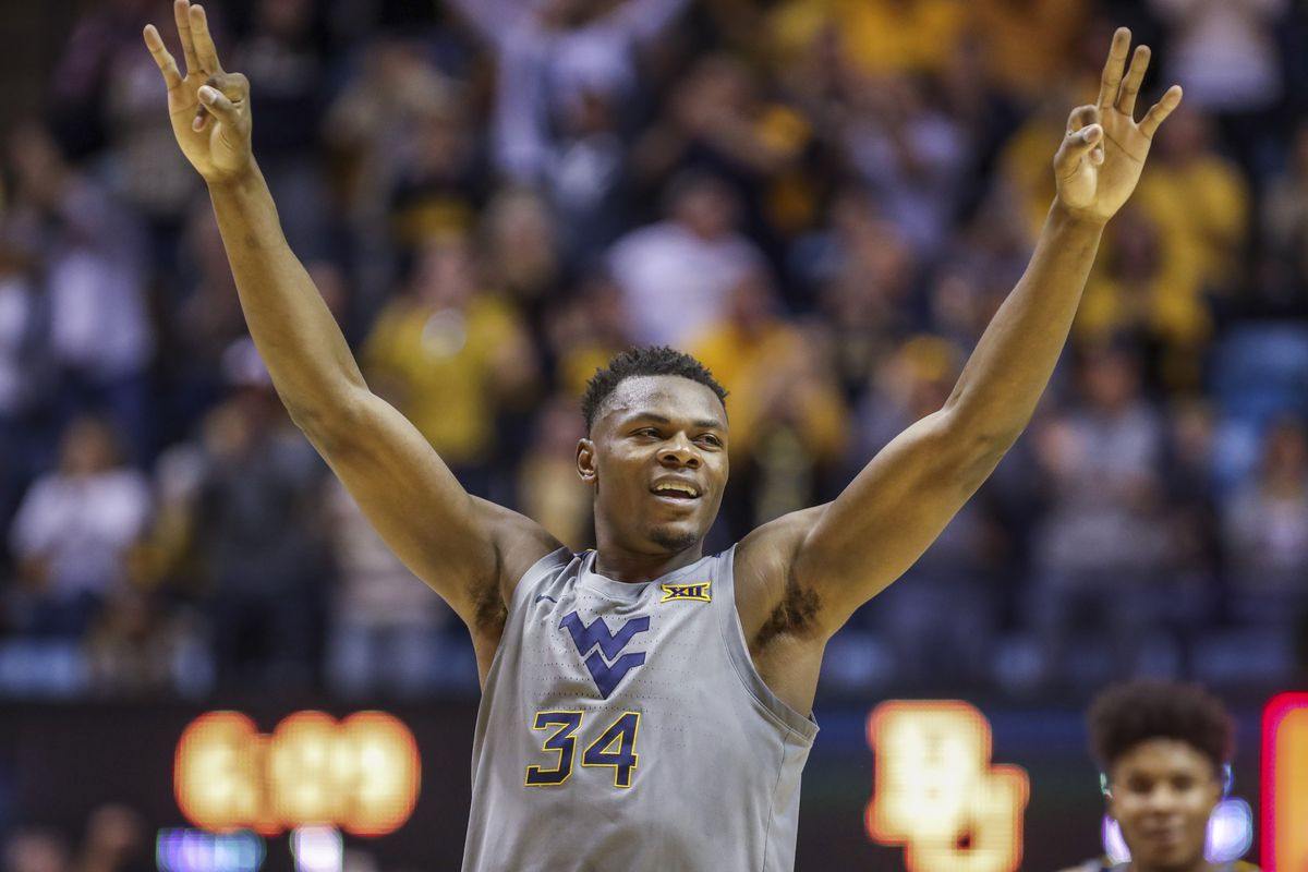 West Virginia Mountaineers forward Oscar Tshiebwe celebrates after a play during the first half against the Baylor Bears at WVU Coliseum.