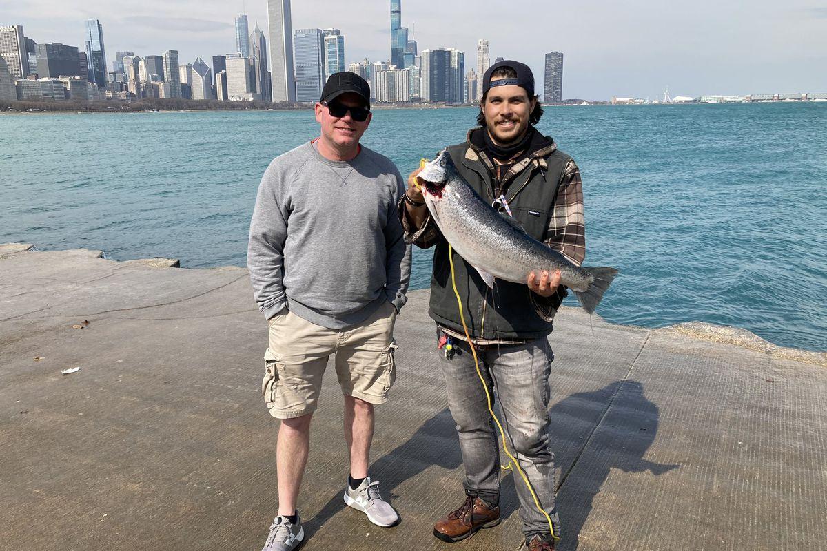 Powerliner Scott (left) netted Quinn Wunar's memorable lakefront fish. Provided photo