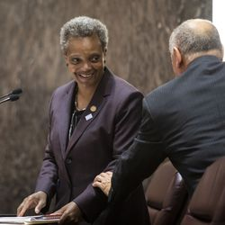 Ald. Ariel Reboyras (30th) chats Mayor Lori Lightfoot following adjournment of her first Chicago City Council meeting at City Hall, Wednesday, May 29, 2019.