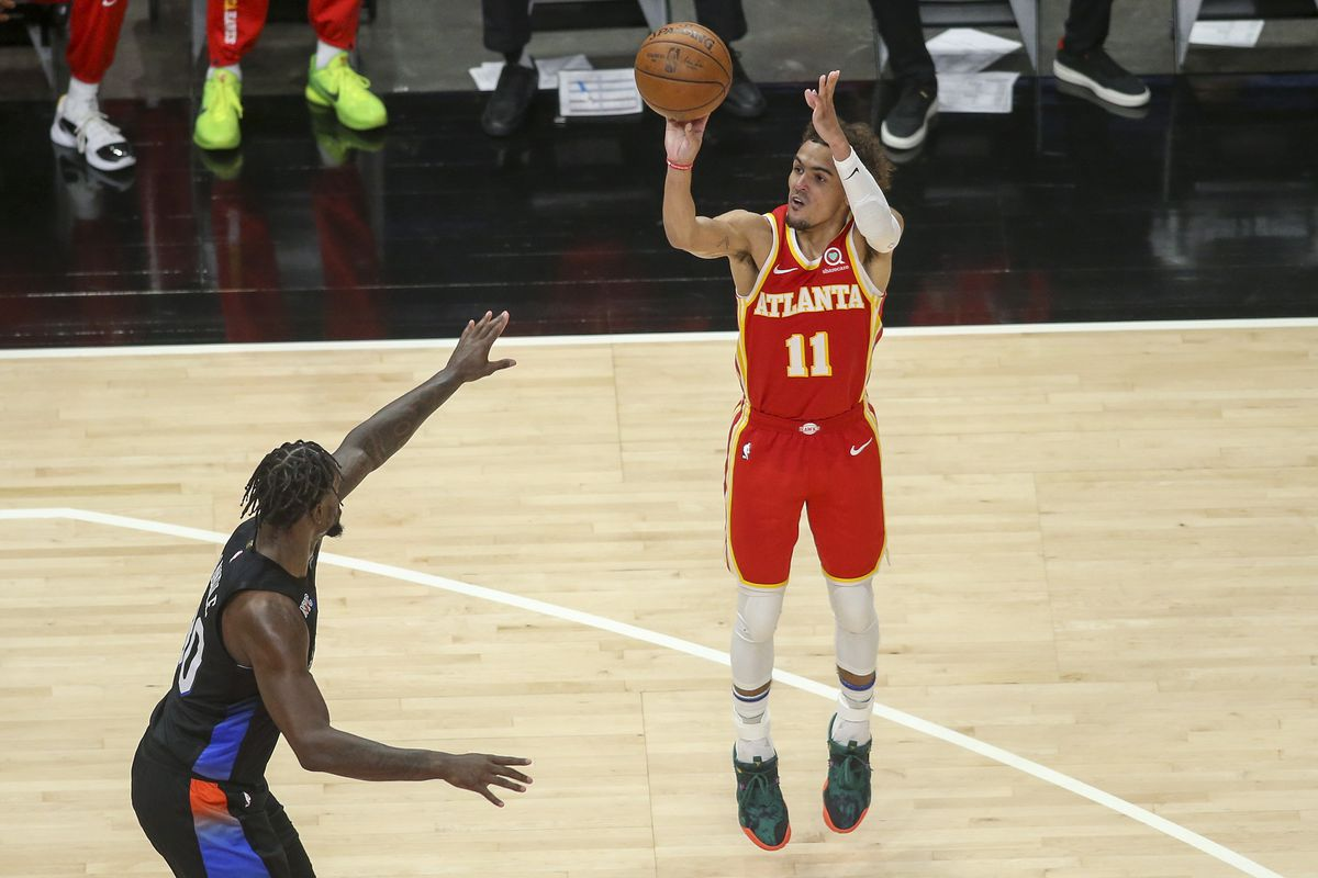 Atlanta Hawks guard Trae Young (11) shoots the ball over New York Knicks forward Julius Randle (30) in the second quarter during game three in the first round of the 2021 NBA Playoffs at State Farm Arena.