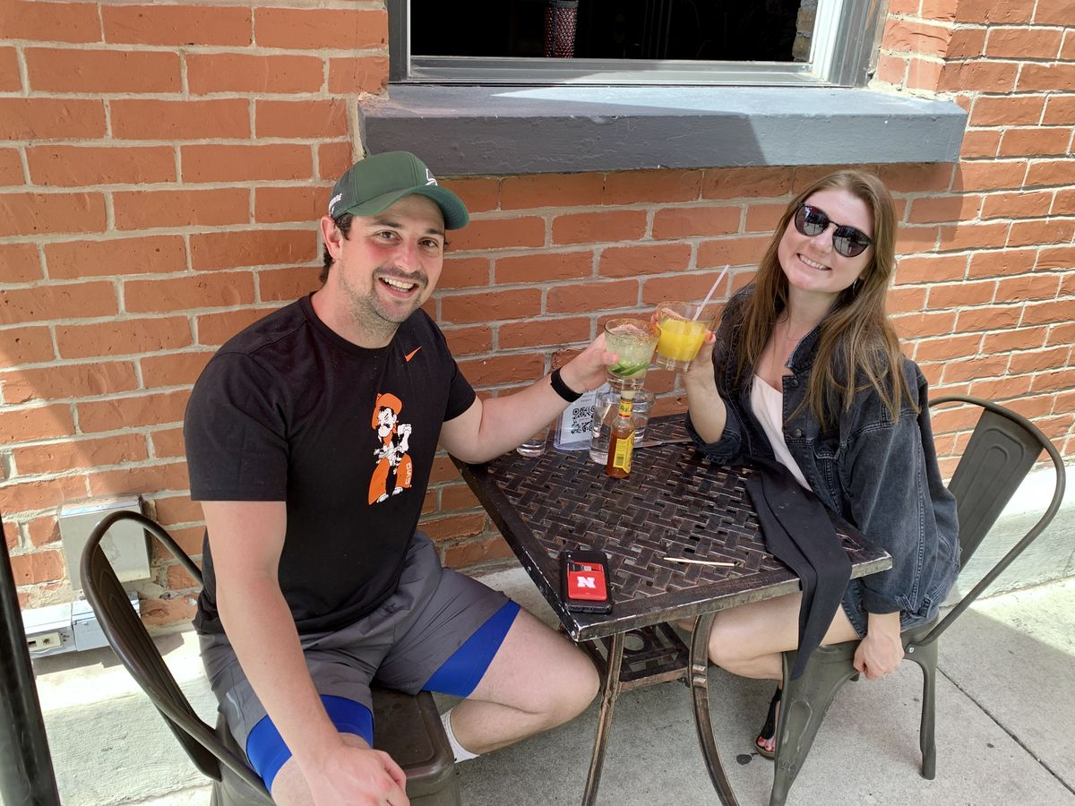 Garrett Vaughan and Jessica Grapenthin have drinks at Pink Taco, 431 N. Wells St., on Wednesday, when Chicago restaurants were allowed to seat outdoor diners following the coronavirus shutdown.
