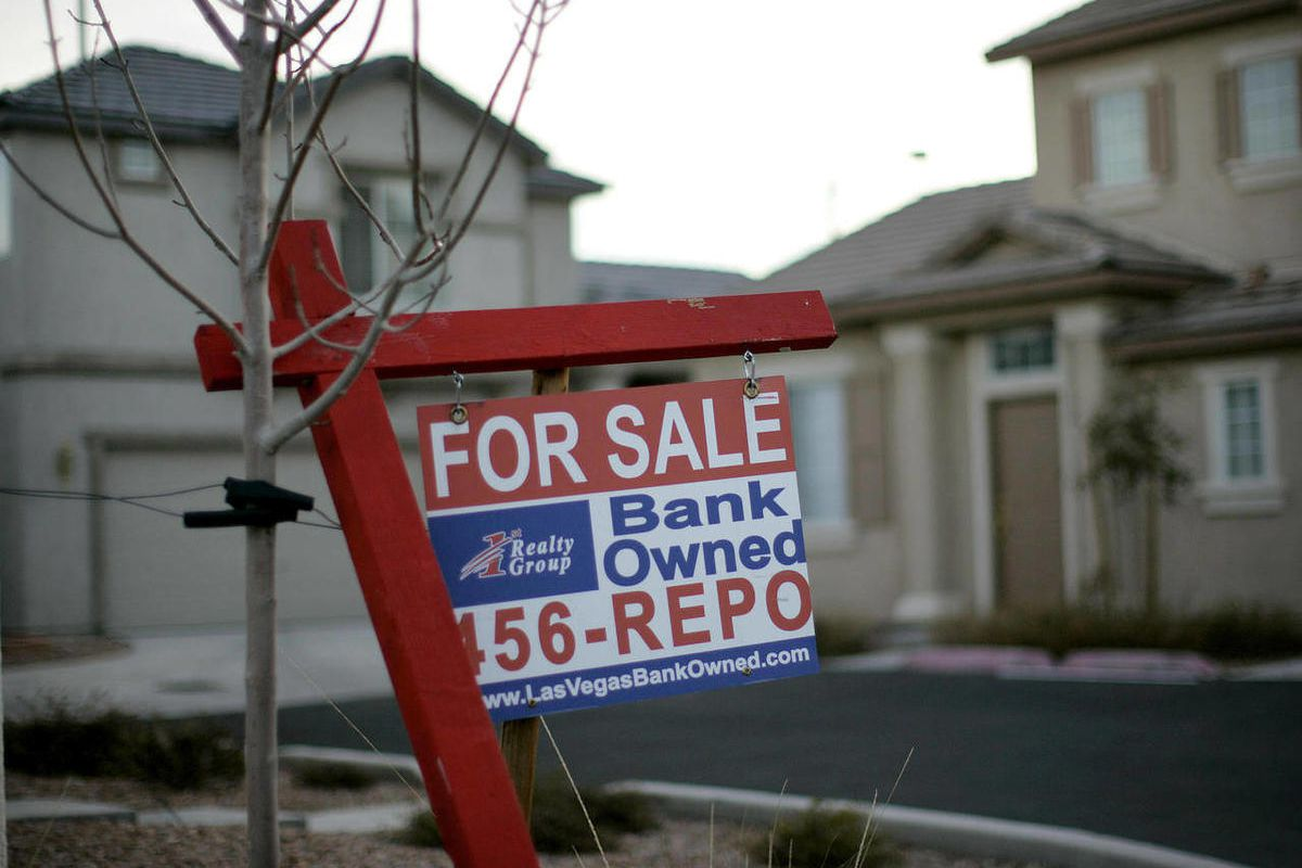 FILE - In this Feb. 8, 2008 file photo, a for sale sign stands in front of a bank-owned home in Las Vegas. More U.S. homes are entering the foreclosure process, setting the stage for a surge in properties repossessed by lenders in 2012. Thirty-one states