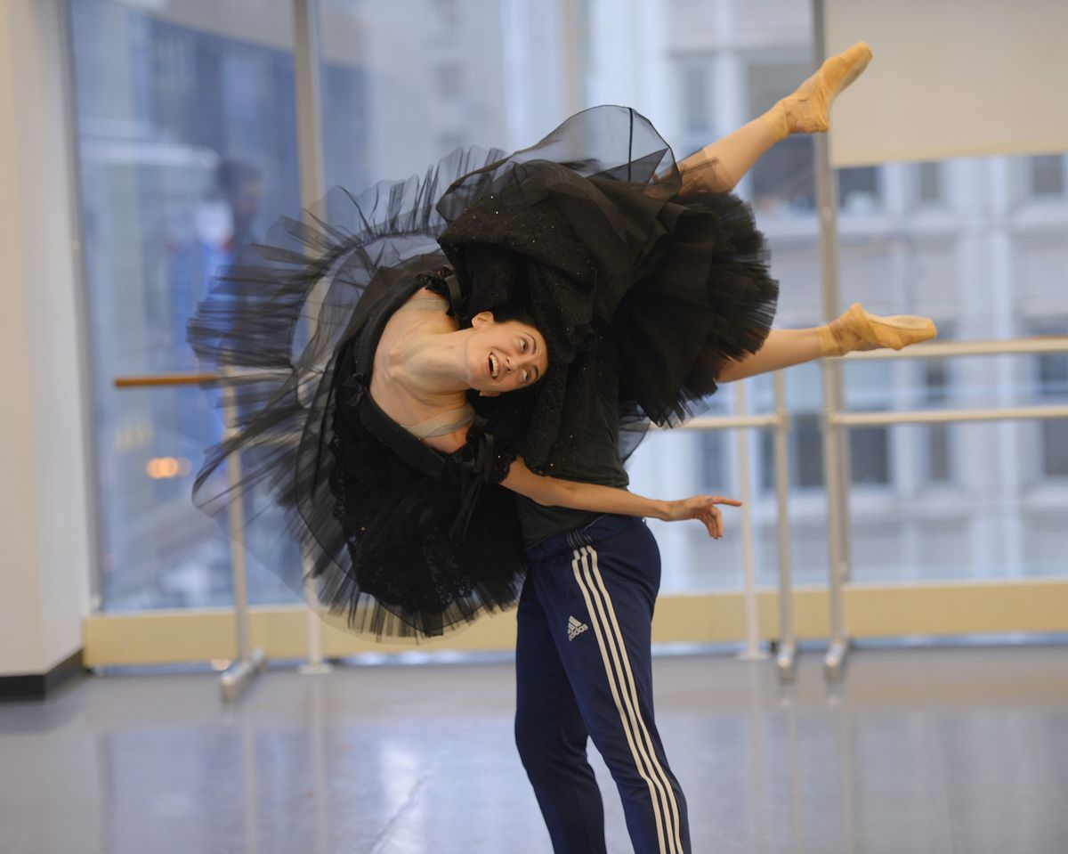 """The Joffrey Ballet's Alberto Velazquez, his face unseen, lifts Victoria Jaiani during a rehearsal for """"Anna Karenina."""""""