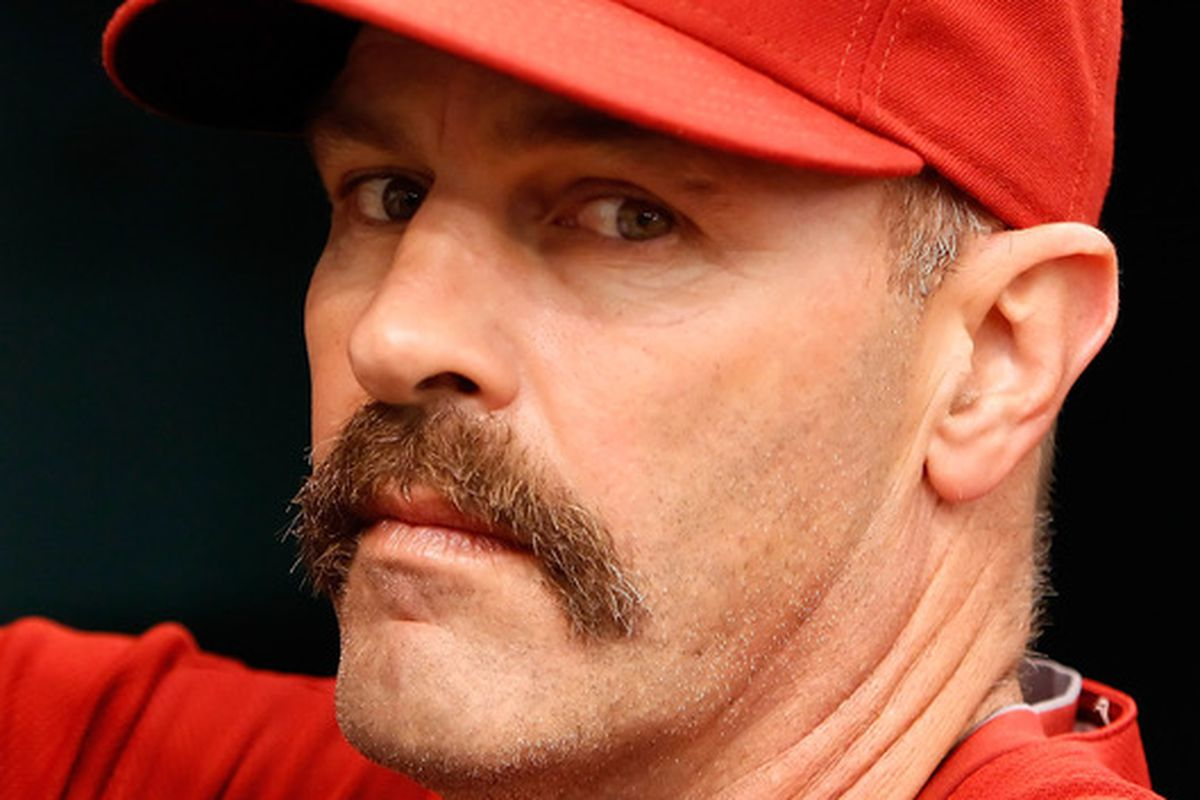Fear the Stache!  Bench coach Kirk Gibson #23 of the Arizona Diamondbacks watches his team against the Tampa Bay Rays during the game at Tropicana Field on June 27, 2010 in St. Petersburg, Florida.  (Photo by J. Meric/Getty Images)