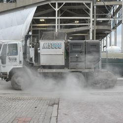 Street sweeping truck cleaning Waveland just north of the northwest corner of the ballpark
