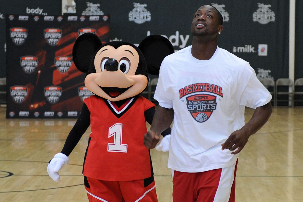Dwyane Wade plays basketball in Mickey's entertainment kingdom. And I love Orlando because it is home of Disney World by the way.