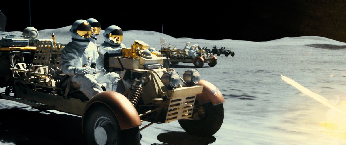 astronauts speed across the moon's surface as they outrun a band of terrorists also driving a lunar module