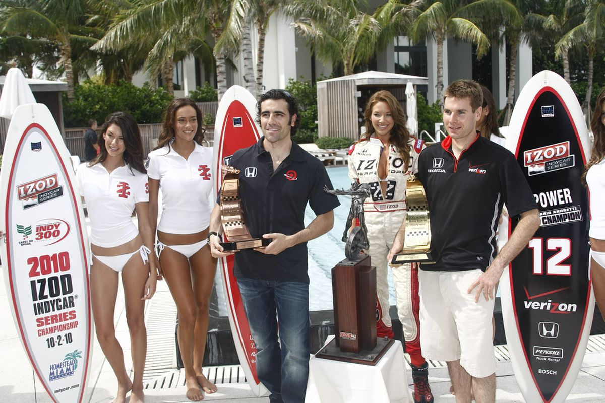 Dario Franchitti and Will Power stand on either side of the new IZOD IndyCar Series championship trophy designed by sculptor Ted Gall. (Photo: IZOD IndyCar Series)