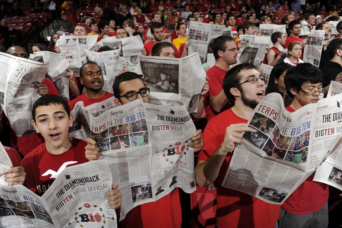 Students with newspapers at a University of Maryland basketball game in 2012.