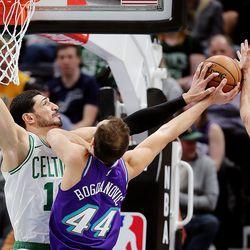 Boston Celtics center Enes Kanter (11) fouls Utah Jazz forward Bojan Bogdanovic (44) at the hoop as the Utah Jazz and the Boston Celtics play an NBA basketball game at Vivint Arena in Salt Lake City on Wednesday, Feb. 26, 2020.
