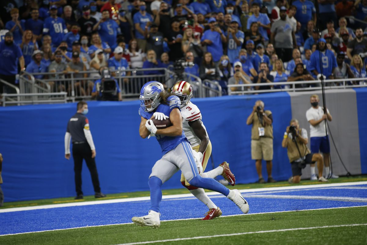 T.J. Hockenson #88 of the Detroit Lions makes a 6-yard touchdown catch during the game against the San Francisco 49ers at Ford Field on September 12, 2021 in Detroit, Michigan. The 49ers defeated the Lions 41-33.