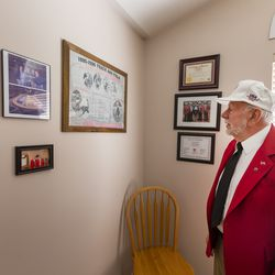"""Longtime track starter Gerard """"Jerry"""" Collet reminisces at his South Jordan home on Tuesday, April 28, 2020, about all the different places around the country that he has been an official."""