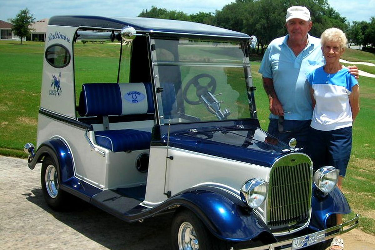 Ed Edwards with his Baltimore Colts-inspired golf cart