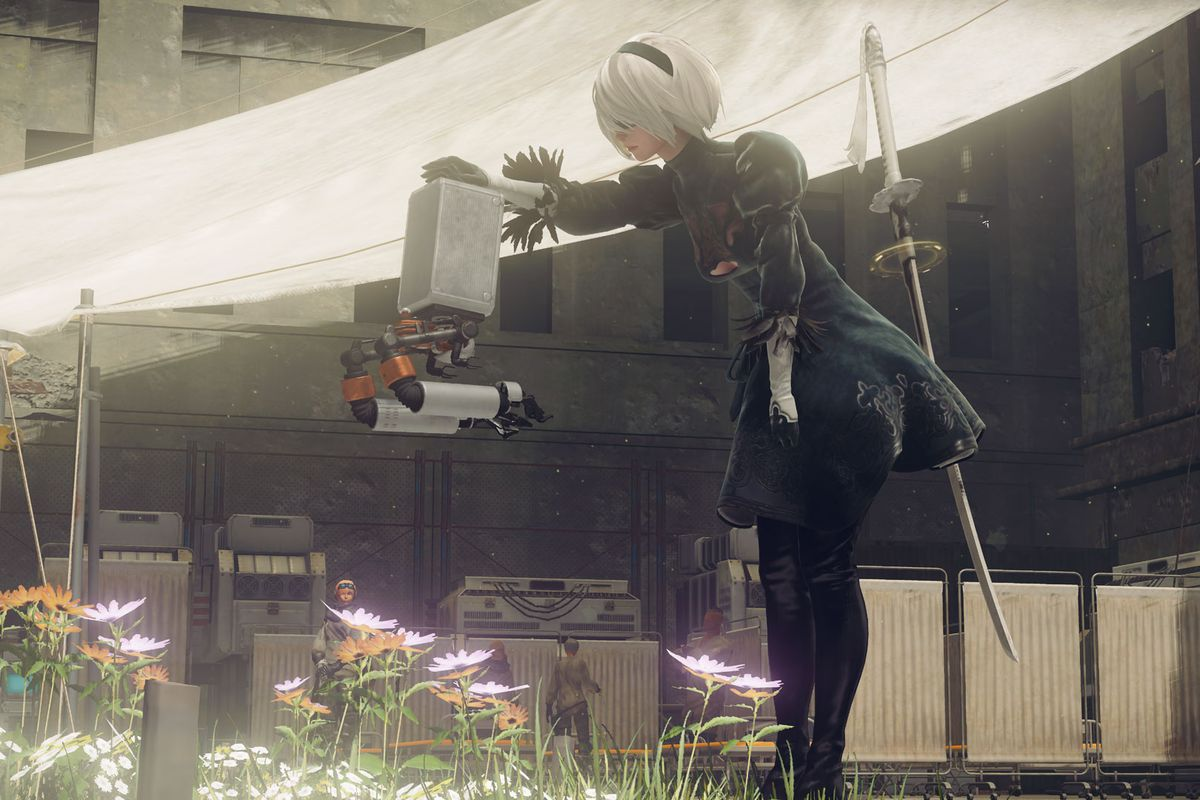 2B pets her satellite robot in a screenshot from Nier: Automata