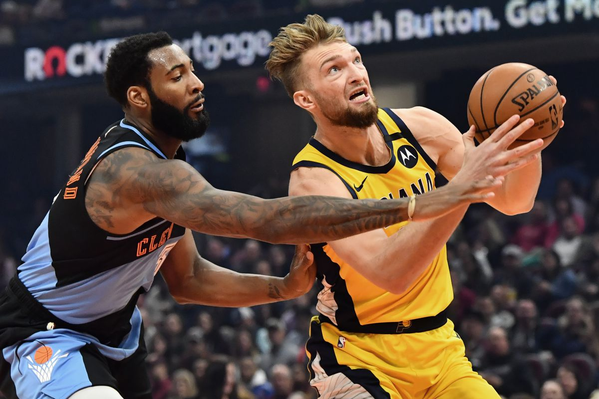 Indiana Pacers forward Domantas Sabonis prepares to shoot the ball past Cleveland Cavaliers center Andre Drummond during the first half at Rocket Mortgage FieldHouse.