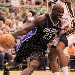 Orlando Magic's Jason Richardson drives past Utah Jazz's  DeMarre Carroll during the first half of an NBA basketball game in Salt Lake City, Saturday April 21, 2012.