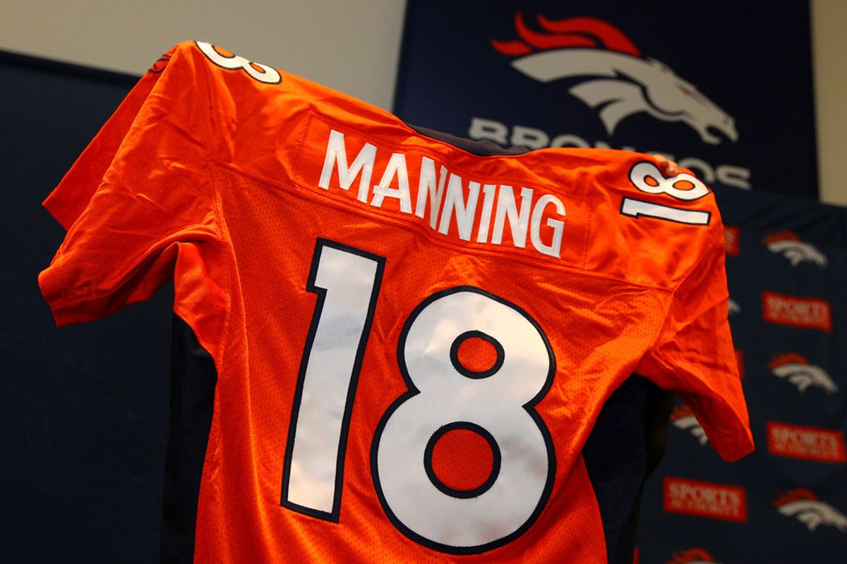 A jersey with Manning and the #18 is brought into the Broncos team meeting room.  (Photo by Doug Pensinger/Getty Images)