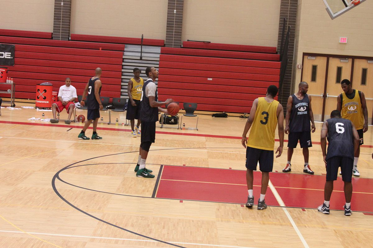 Adreian Payne (shooting) and Derrick Nix went head-to-head in the Lansing Moneyball Pro-Am Sunday (Photo: Patrick Hayes).