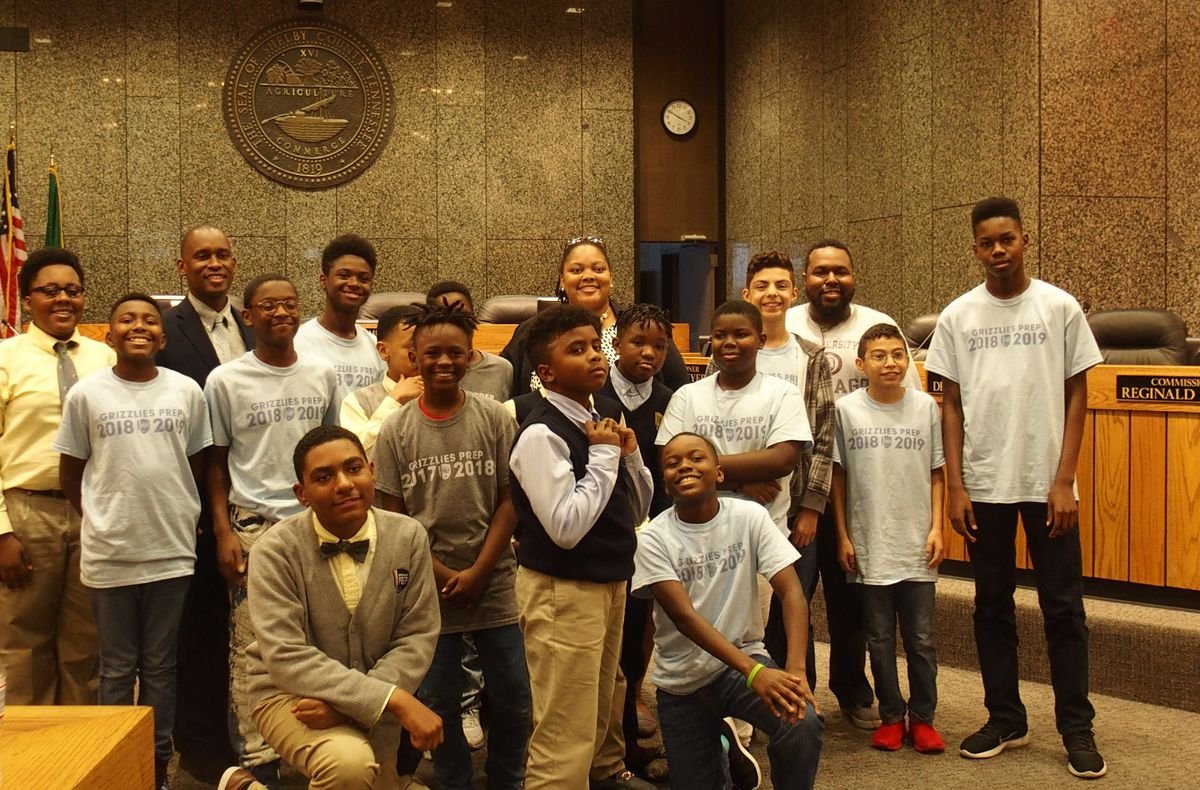 Memphis Grizzlies Preparatory Charter School students visit county commissioners Tami Sawyer and Van Turner (back row), who were key in the city's campaign to remove Confederate statues.