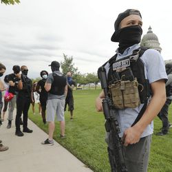 Insurgence USA protesters clash with Utah Citizens' Alarm members as the groups rally at the Capitol in Salt Lake City on Wednesday, July 22, 2020.