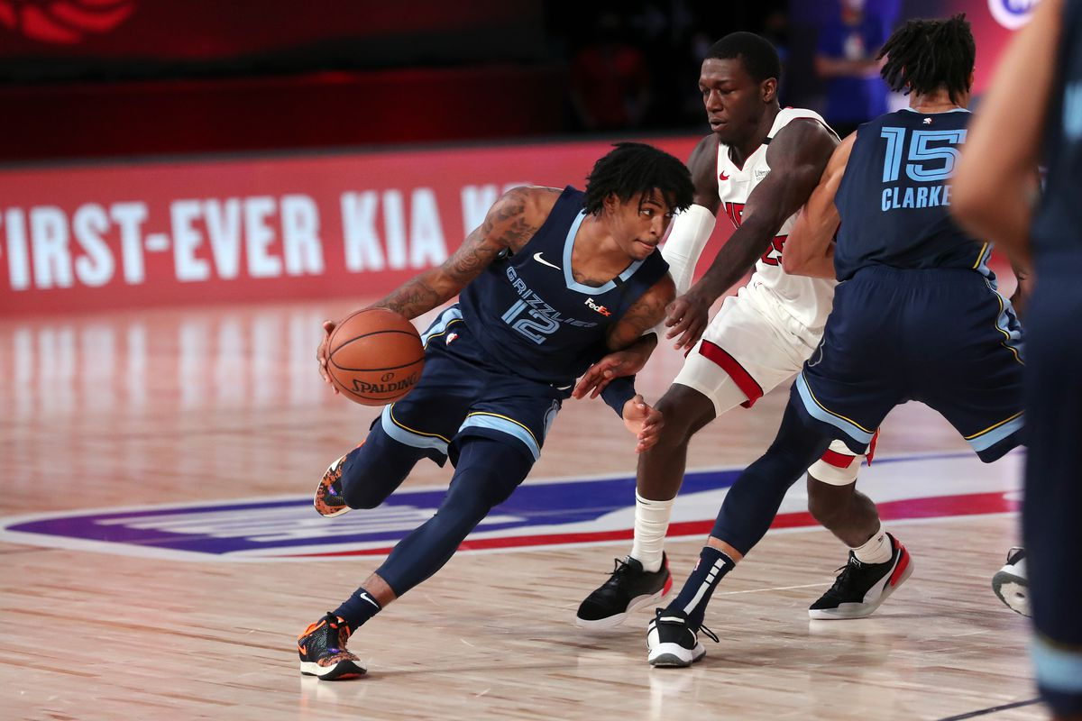Ja Morant of the Memphis Grizzlies handles the ball during the game against the Miami Heat during a scrimmage on July 28, 2020 at The Visa Athletic Center at ESPN Wide World Of Sports Complex in Reunion, Florida.