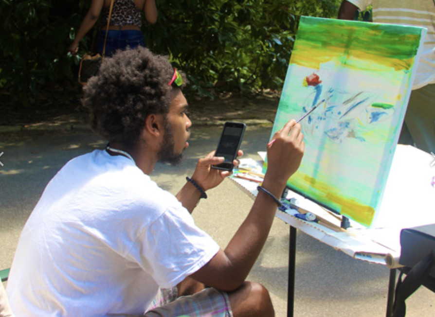 Artist painting on a canvas