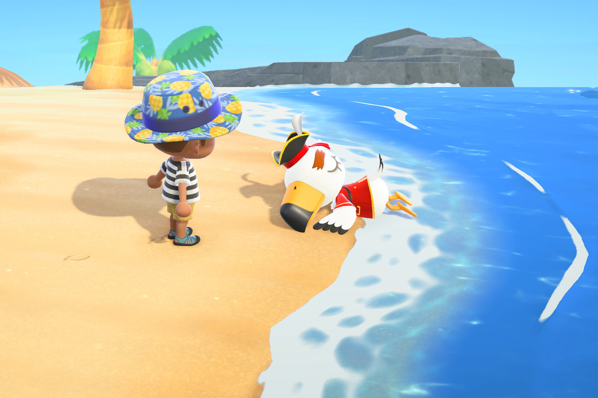 Gulliver on the beach wearing a pirate outfit