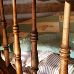 The Daughters of the Utah Pioneers recently refurbished its historic cabin in Santaquin. Here, old and new spindles are used on an old bed. The DUP is collecting items of period age to include in the museum.