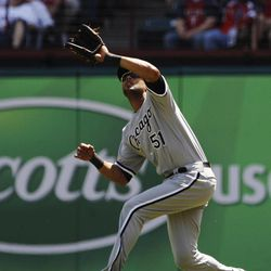 Chicago White Sox center fielder Alex Rios catches a fly ball from Texas Rangers' Michael Young during the fourth inning of a baseball game, Friday, April 6, 2012, in Arlington, Texas.