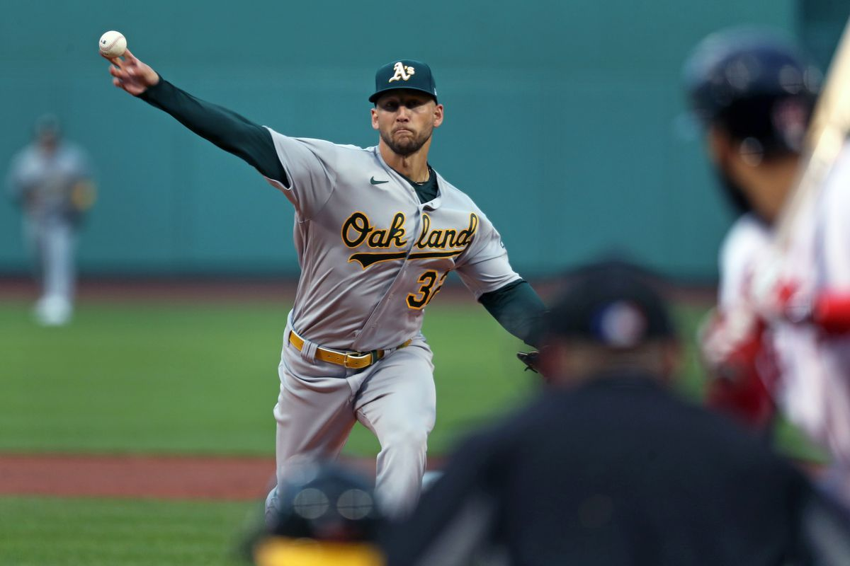 Oakland Athletics starting pitcher James Kaprielian fires the first pitch of his major league career to the Red Sox Marwin Gonzalez during a regular season MLB game against the visiting Oakland Athletics on May 12, 2021 at Fenway Park in Boston