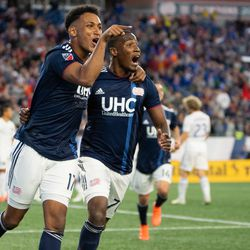 FOXBOROUGH, MA - MAY 11: New England Revolution forward Juan Agudelo #17 celebrates with forward Cristian Penilla #70 after Agudelo's first half goal against the San Jose Earthquakes at Gillette Stadium on May 11, 2019 in Foxborough, Massachusetts. (Photo by J. Alexander Dolan - The Bent Musket)