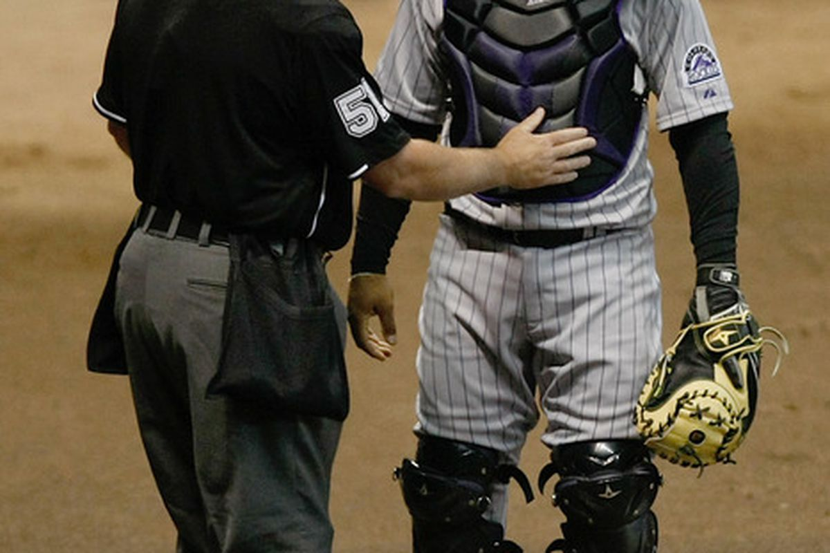 Willin Rosario of the Rockies discusses the music of Barenaked Ladies with umpire Marvin Hudson during Wednesday's game.