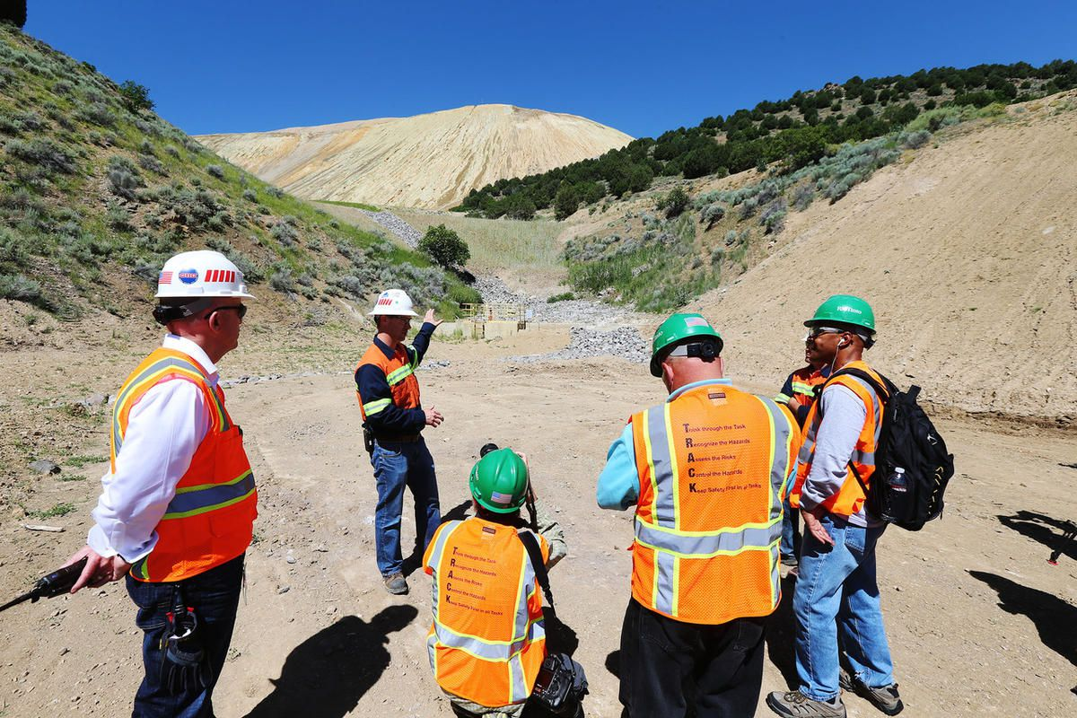 FILE - Rio Tinto employee Zeb Kenyon talks with media while on a tour at Kennecott Copper Monday, June 22, 2015, showing areas of the dump sites that are going to be reclaimed with vegetation over the next several years. Rio Tinto Kennecott announced Thur