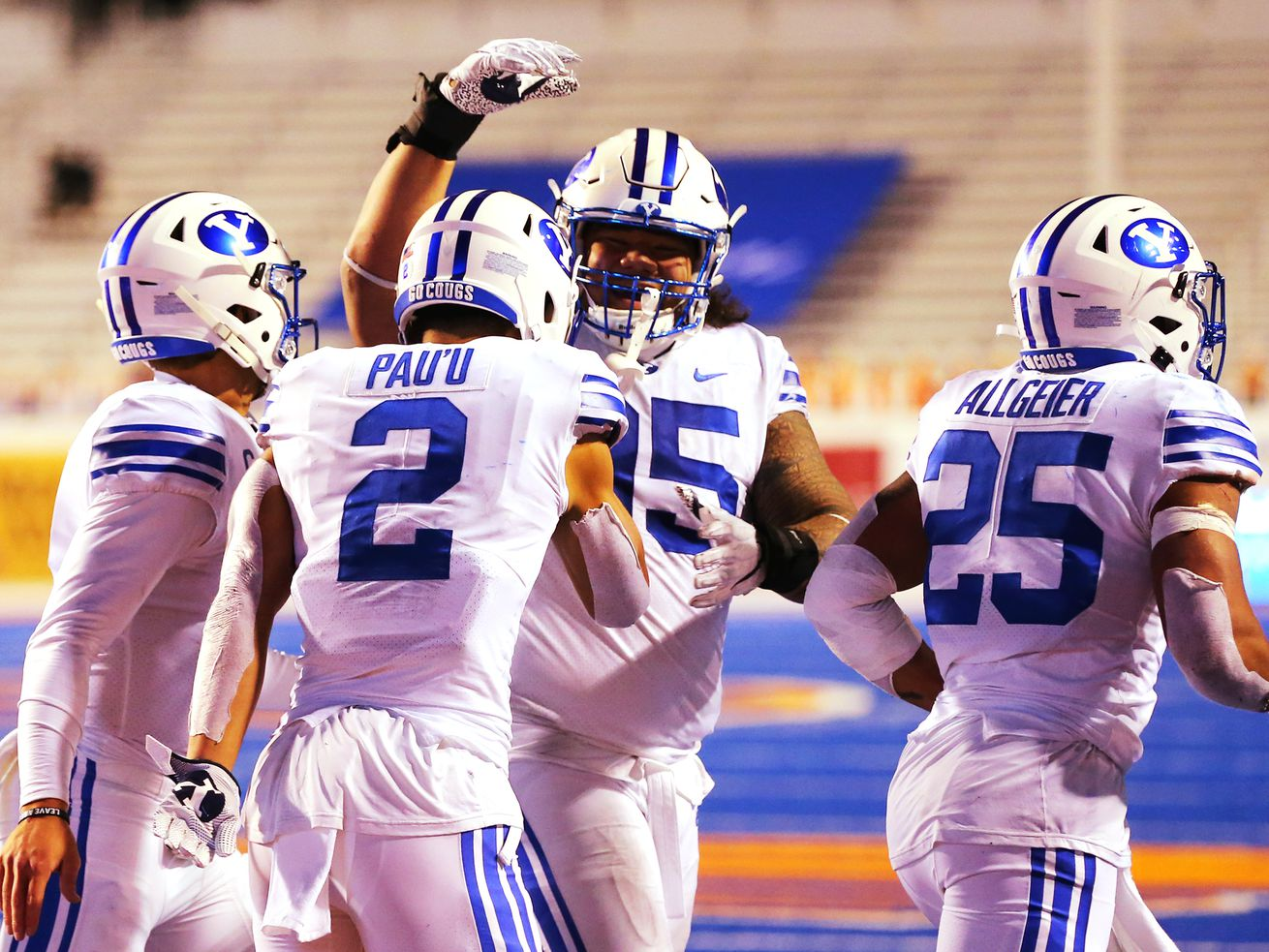 Brigham Young Cougars wide receiver Neil Pau'u (2) celebrates a touchdown with teammates as BYU and Boise State play a college football game at Albertsons Stadium in Boise on Friday, Nov. 6, 2020. BYU won 51-17.