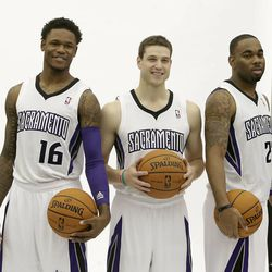 Sacramento Kings guards, from left, Ben McLemore, Jimmer Fredette and Marcus Thornton pose for photos during the team's NBA basketball media day in Sacramento, Calif., Monday, Sept. 30, 2013.