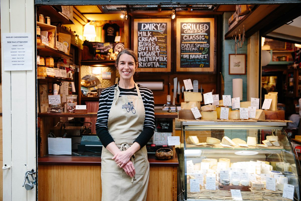 Anne Saxelby stands in front of Saxelby Cheesemongers, her New York City cheese shop
