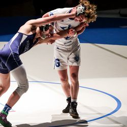 Pleasant Grove's Alex Emmer, left, defeats Koda DeAtley, also of Pleasant Grove, in the 138-pound finals match at the 6A wrestling state championship at Corner Canyon High School in Draper on Friday, Feb. 19, 2021.