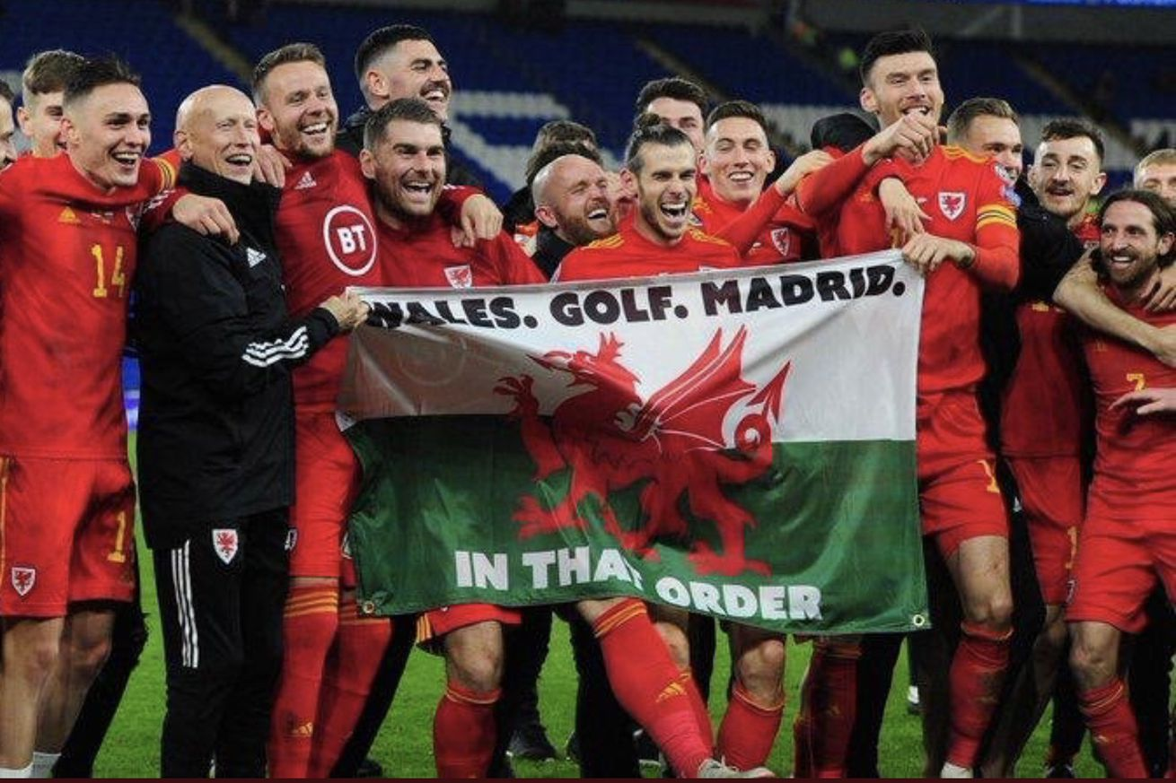 Bale Celebrates Euro 2020 Qualification with ?Wales, Golf, Madrid ? In that Order? Flag