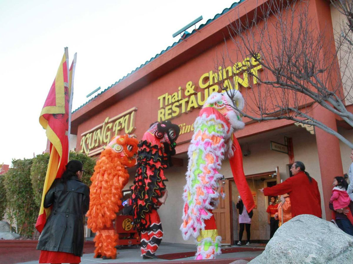 The exterior of a restaurant with a Chinese New Year celebration with dragons
