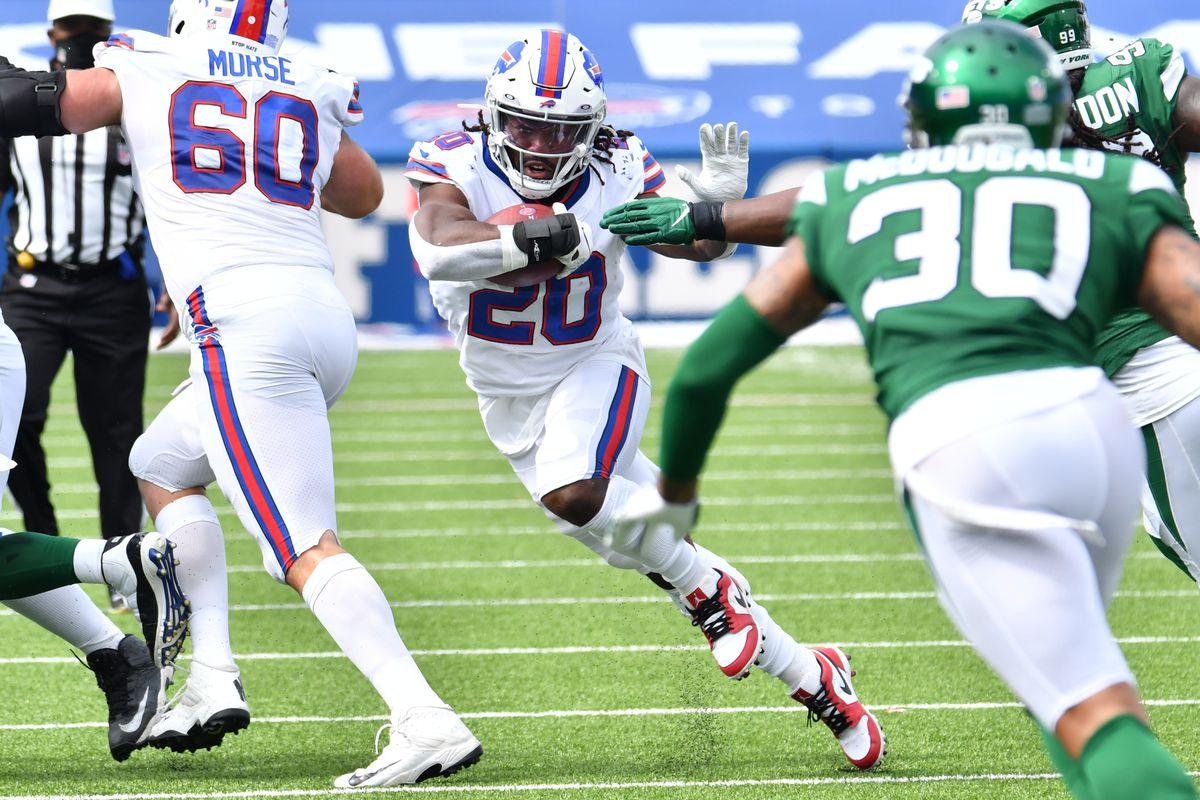 Buffalo Bills running back Zack Moss runs through a hole as #30 looks to make a tackle during the second quarter at Bills Stadium.