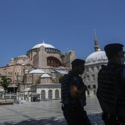Armed police patrol outside the Byzantine-era Hagia Sophia, one of Istanbul's main tourist attractions in the historic Sultanahmet district of Istanbul, Thursday, June 25, 2020. Turkey's highest administrative court on Thursday July 2, 2020, began considering a request for the UNESCO World Heritage site that now serves as a museum be reverted back into a mosque.