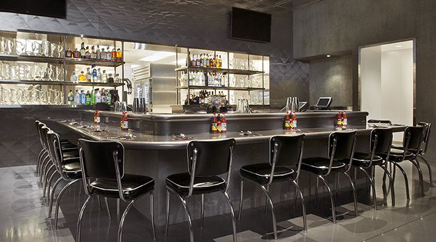 A lunch counter with chairs