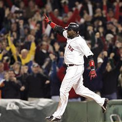 Boston's David Ortiz rounds the bases after his game-winning single against New York Yankees pitcher Esteban Loaiza.