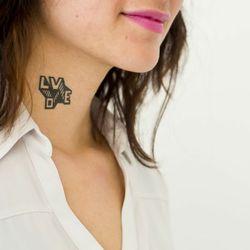 """<a href=""""http://tattly.com/""""><b>Tattly</b></a> tattoos"""
