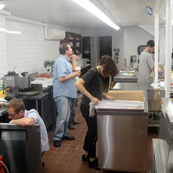 The team building the new, bright, open kitchen.